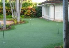 Southwest Greens backyard putting area with synthetic grass lawn and landscape 1