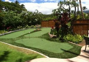 Southwest Greens fake grass yard with synthetic turf putting area and surrounding landscape