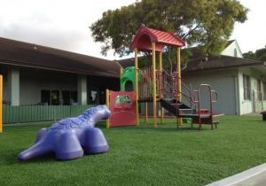 Southwest Greens play area playground safety surface fake grass lawn 2